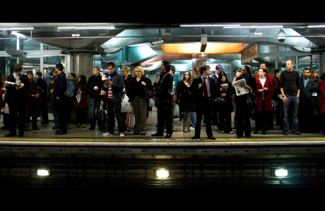 Commuters in London waiting at a Platform